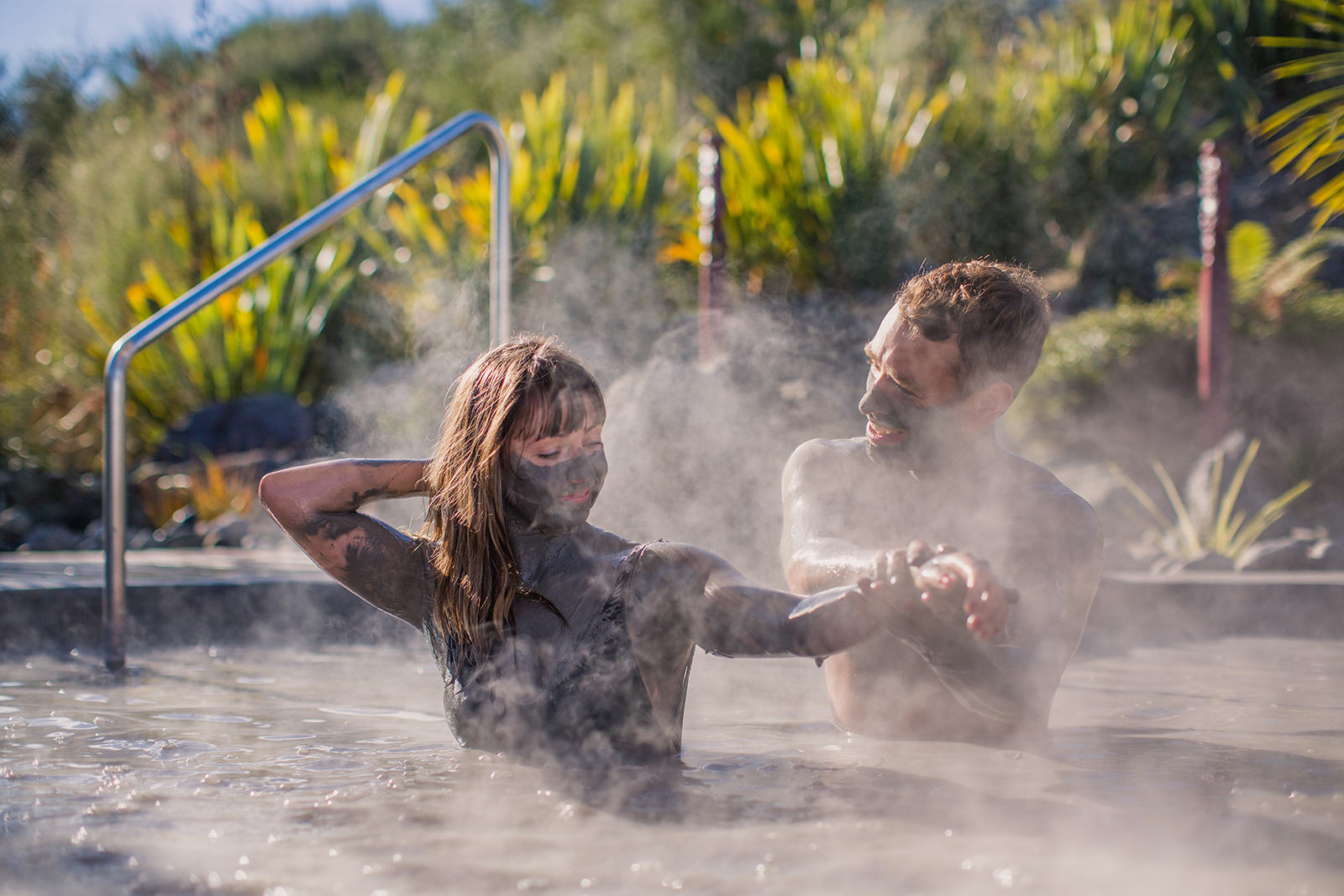Two people in a mud spa