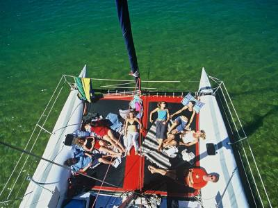 view from above of relaxed people on a boat