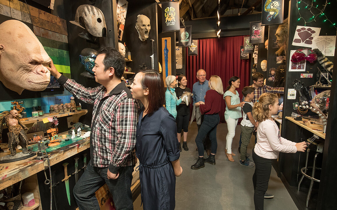 People examining displays in Weta Workshop's