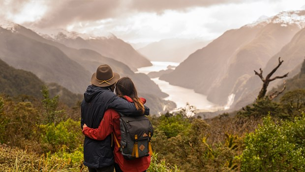 Couple looking down at Doubtful Sound from Wilmot Pass