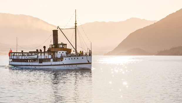 The TSS Earnslaw on Lake Wakatipu with sunlight reflecting off the water