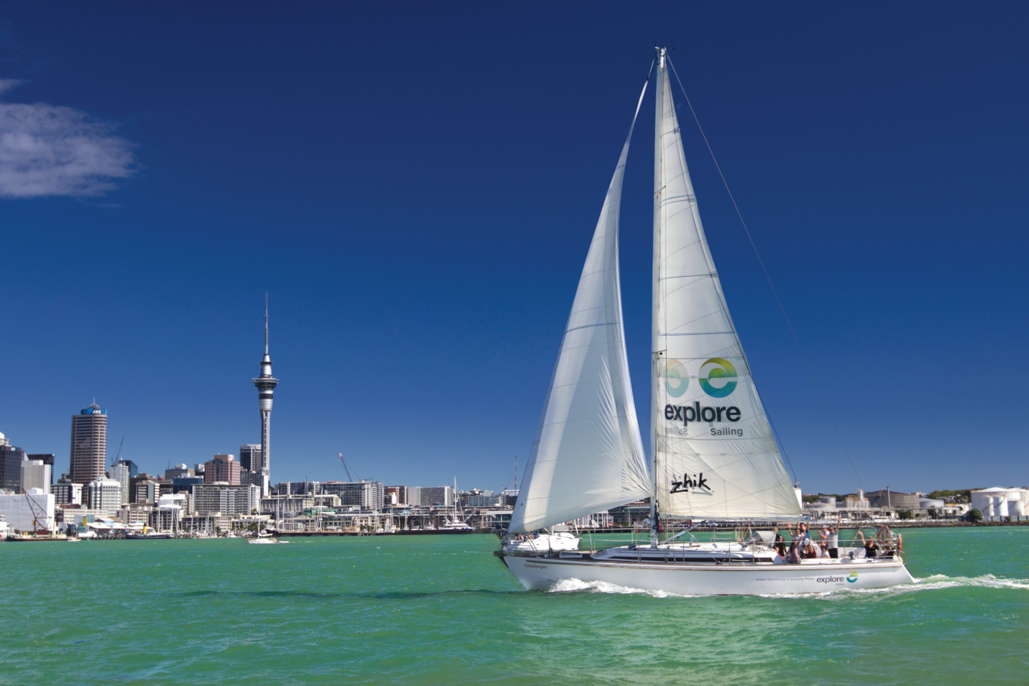 Sailboat on Auckland harbour in front of Sky Tower