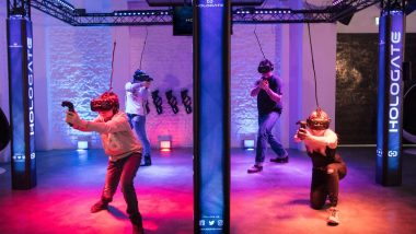 Four people playing a VR combat game